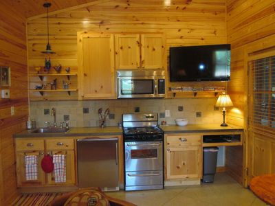 Kitchen boasts stainless appliances and an HDTV with satellite & DVD player.