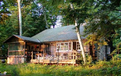 Historic log cabin lakeside view with Deck & Screen Porch