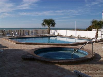 Condo Pool and Jacuzzi, beach is on the other side of the fence.