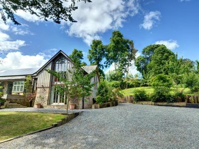 Photo for Bright holiday home in beautiful surroundings, authentic walls, fireplaces and garden