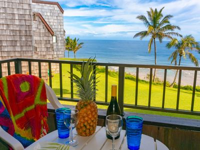 Photo for Top floor, cute decor, beach gear, amazing oceanfront view!!