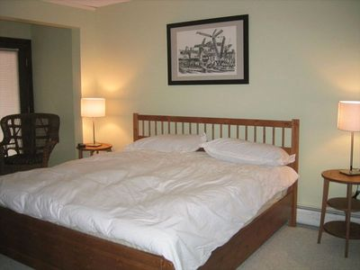 One of four bedrooms. Brand new king bed with new bedding.