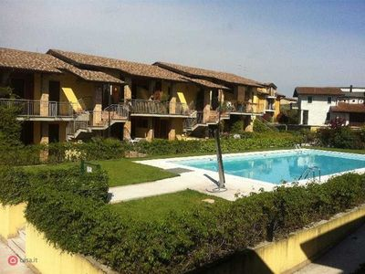 Photo for Apartment in residence with swimming pool 4 km from Lake Garda