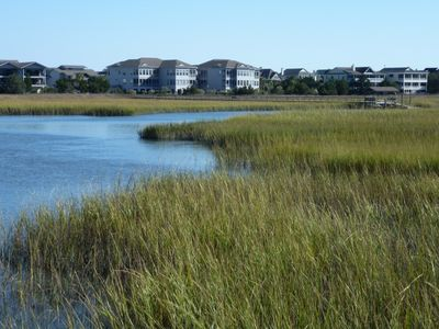 Photo for Salt marsh creek condo, walk to beach, 2 pools, screened porch, sunroom, wet bar