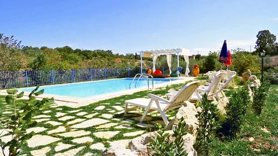 Photo for Trulli immersed in nature: kitchen, private pool, Wifi, Bioproducts and tranquility ...