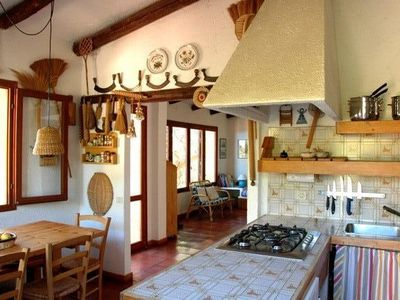 Photo for Sardinia: spacious and bright villa with garden a few meters from the sea
