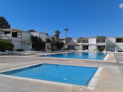 Photo for Apartment with terrace, two swimming pools and parking, near the sea