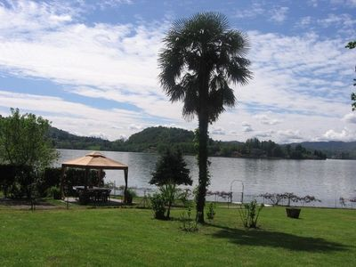 Photo for STUNNING LARGE APARTMENT WITH VIEW, GARDEN AND DIRECT ACCESS TO LAKE ORTA