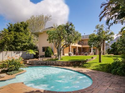 Photo for Large and airy Constantia family home with pool