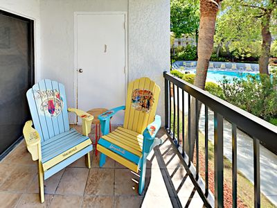 Balcony - Welcome to Myrtle Beach! Kick back in an Adirondack chairs on your balcony, offering views of the shared pool.