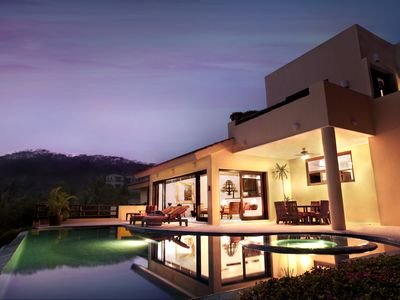 Infinity edge pool and furnished outdoor living space