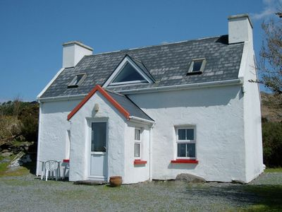 Photo for 150 year old traditional Irish cottage overlooking the Kenmare River