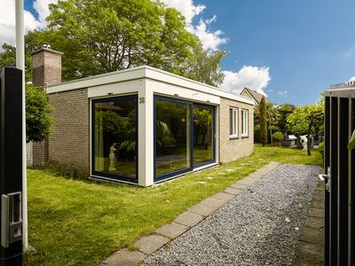 Photo for Charming holiday home with a sauna and a splendid lounge area in the garden