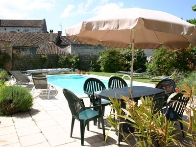 Photo for Two beautiful restored houses in Vieux Mareuil with private courtyard and pool