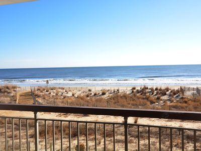 Nicely-furnished 2 bedroom oceanfront condo with free wiFi located midtown and just steps to the beach!