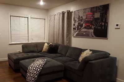 Large Living Room with Sectional Sofa and TV entertainment with DVD