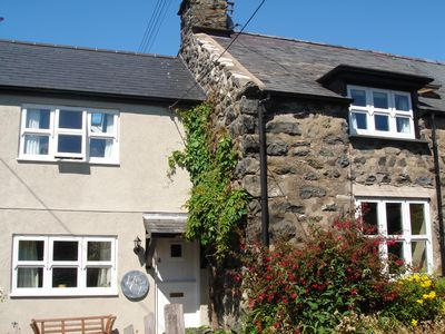 Photo for Pretty cottage in village setting, within walking distance of the sea.