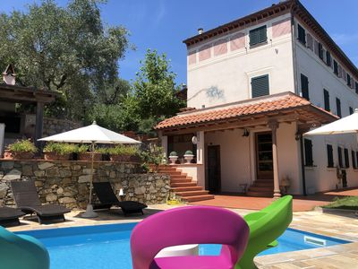 Photo for Apartment with swimming pool in Versilia: a few steps from the sea, from Lucca and Pisa