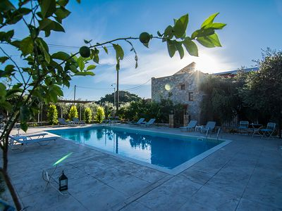 Photo for Little stone castle in famous Stoupa with pool