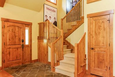 Wooden staircase landing on first floor