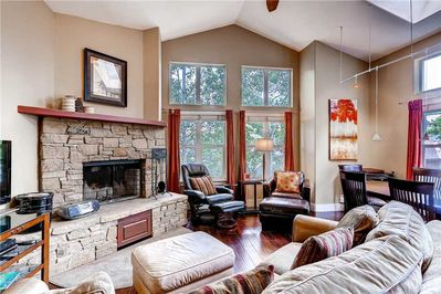 Main living area cozy couch lounge chairs fireplace - Park City Lodging-946 Woodside