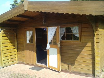 Photo for Holiday in a simple, rustic log cabin, beach about 1000 meters, sun terrace