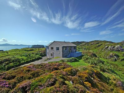 Photo for Detached stone fronted cottage in a quiet location on the Lamb's Head Peninsula offering panor…