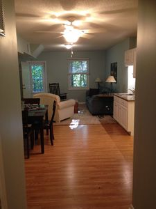 From Master BR looking through Kitchen/Living Room thru front door to woods.