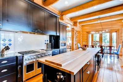 Gourmet Kitchen - featuring six-burner gas stove, two ovens, grantie counter tops and large butcher block island with seating