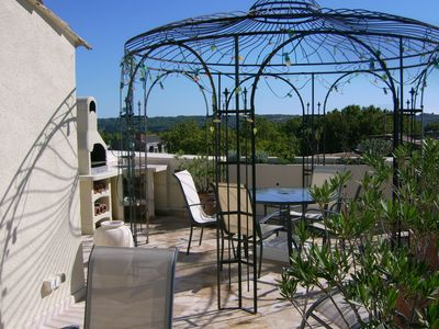 Photo for APARTMENT OF CHARM WITH PRIVATIVE TERRACE ON THE ROOTH IN THE OLD PEZENAS CITY