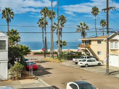 Photo for Oceanview condo located just steps from the beach