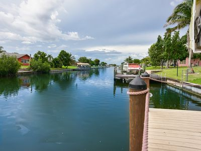 Photo for Waterfront Property, private hot tub, heated pool,waterfall,Fishing on the dock