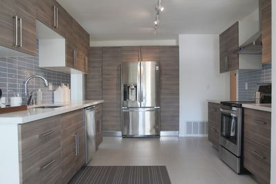 Newly remodeled modern kitchen with all stainless LG appliances.