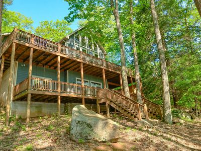 Lakefront home with dock slip, sauna, hot tub, pool table and fire pit!