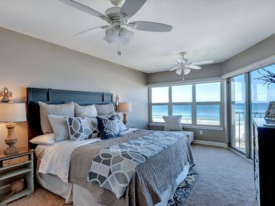 Master bedroom overlooging the emerald waters of the beach