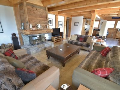 Photo for 5 Star 5 bed chalet for 13+, chimney, games room and jacuzzi!