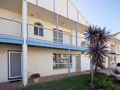 Photo for A three bedroom townhouse, just 100 metres from the beach.