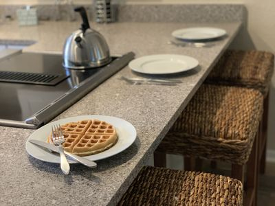 Our granite breakfast bar is a great place to fuel up before a big beach day