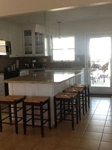 Kitchen opens to back deck with pass through window for easy dining access.