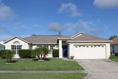 Front of this 3 bedroom, 2 bathroom pool home with 2 car garage