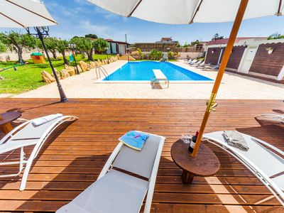 Photo for Big pool, lush garden, by the sea