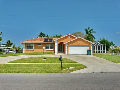 Photo for Cozy, corner lot house w/ heated pool & short walk to Tigertail Beach