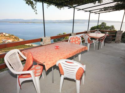 Photo for Two bedroom apartment with terrace and sea view Cove Vela Farska (Brač) (A-2897-a)