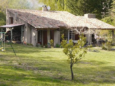 Photo for Provencal house with swimming pool facing the luberon on 15 000 m of wooded land