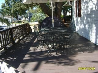 Front deck with table , chairs, umbrella  and propane grill