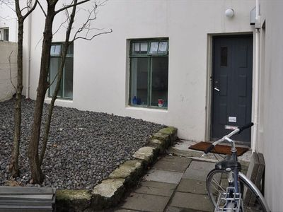 The entrance to the flat is set back from the street in a small courtyard.