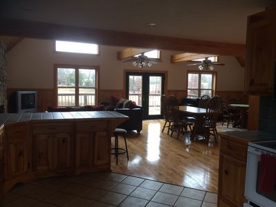 When entering the cabin, the kitchen opens up to large living area on 2nd floor