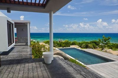 View from lounge area on terrace over pool and Caribbean Sea