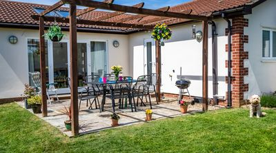 Enjoy the South facing patio-perfect for breakfast or BBQs in the sun