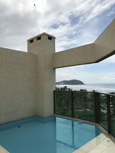 Photo for Foot in the sand with incredible view, top-level condo, great building